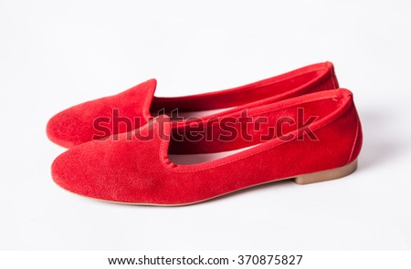 Red shoes on low heel, white background