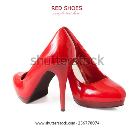 Red shoes pair isolated on white background with sample text - stock photo