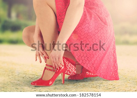 red shoes red skirt and sunset  - stock photo