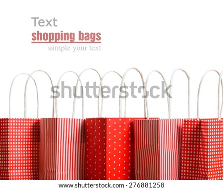 red shopping bags on a white background - stock photo