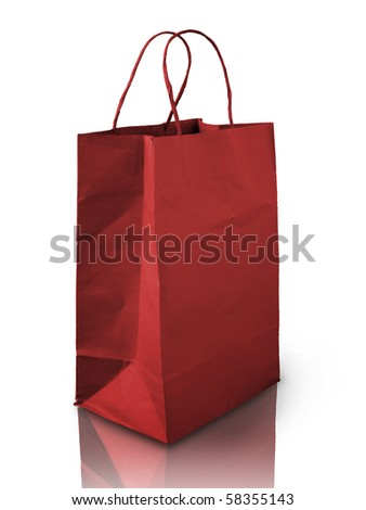 Red shopping paper bag on reflect floor - stock photo
