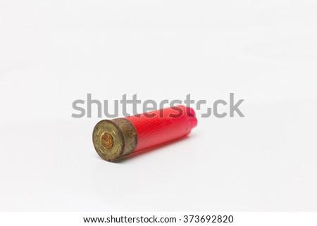 Red shotgun shell used.On white background. - stock photo
