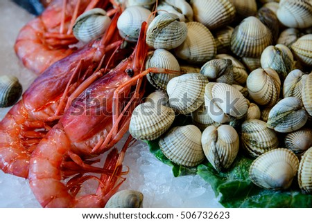 Red Shrimps and clams over ice in fish shop