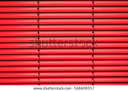 Red shutter blind in a house window