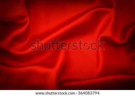 Red silk background. Dark toned with vignette