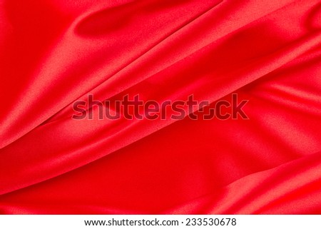 Red silk drapery. Close up. Whole background. - stock photo