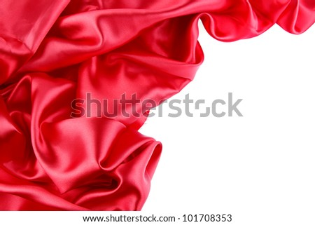 Red silk fabric on plain background