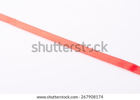 Red silk ribbon, in the form  on a white background