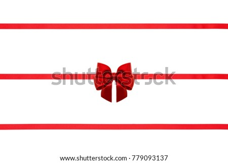 Red silk ribbons with bows on white background