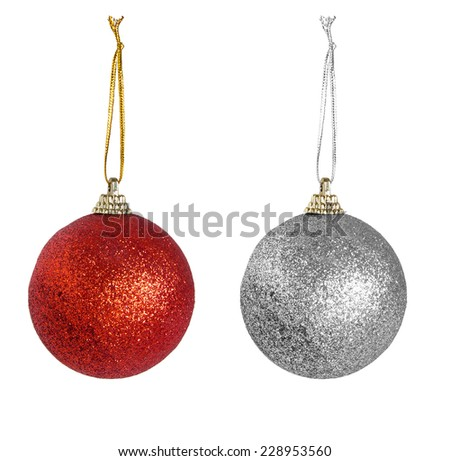 Red, silver Christmas baubles, tree decorations with string, isolated on white. - stock photo