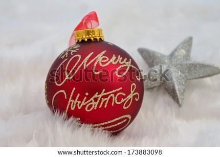 Red silver Christmas decoration with fake snow made of white fur - stock photo