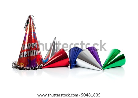 Red, silver, green and blue party hats on a white background - stock photo