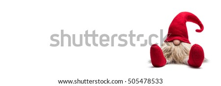 Red sitting christmas dwarf with pointed cap isolated as template