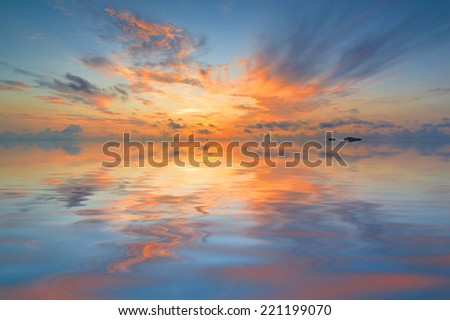 Red skies sunset with reflection. Natural background concept. - stock photo