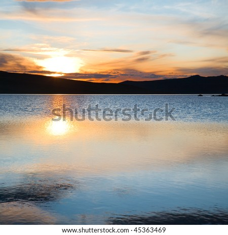 Red sky and blue water - stock photo