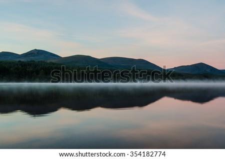 Red Sky over Loch Morlich  - stock photo