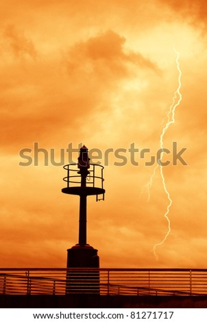 red sky with lightning over the dock - stock photo