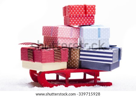 Red sled full of gift boxes, isolated on white background - stock photo
