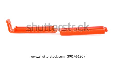 Red small Plastic package clamp peg pin isolated over the white background