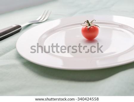 red small tomato - stock photo