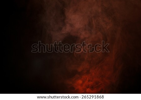 Red smoke over black studio background - stock photo