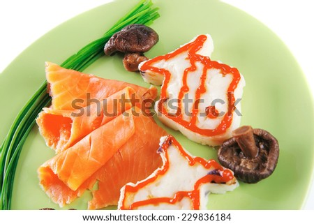 red smoked salmon with mash served on green plate - stock photo