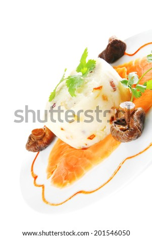 red smoked salmon with mash served on white plate - stock photo