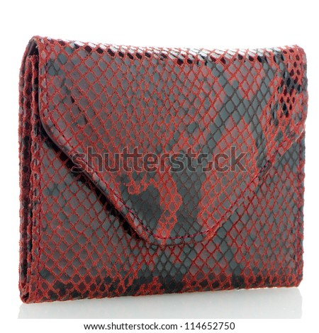 Red snake skin purse isolated on white background.