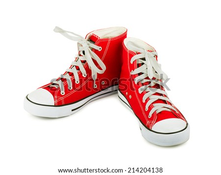 Red sneakers on a white background - stock photo