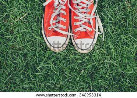 red sneakers on grass