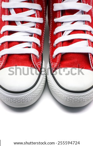 Red sneakers on white background - stock photo
