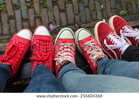Red sneakers view from above, wonderful ladies day, Amsterdam town, Netherlands - stock photo