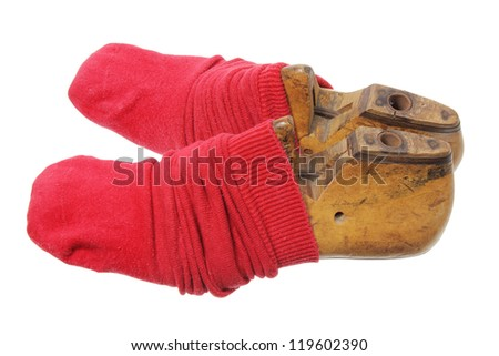 Red Socks on Foot Lasts on White Background - stock photo