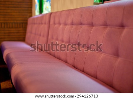 Red Sofa in the cafe. Side view