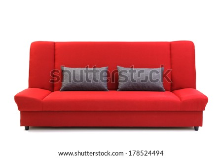 Red sofa with pillows, isolated on white.  - stock photo