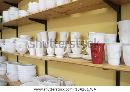 Red Solo Cup And Unfinished Pottery - stock photo