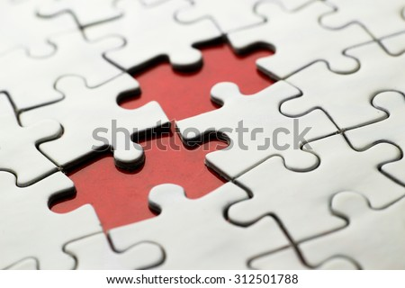 Red space among white jigsaw puzzle.