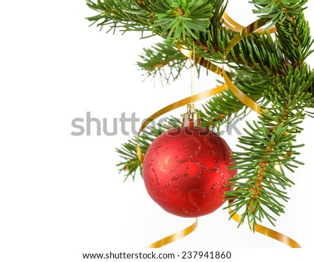 red sparkling ball on the spruce branch - stock photo