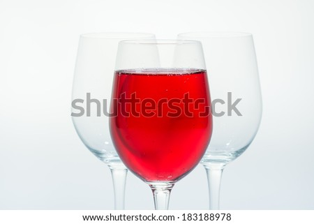 red sparkling water in a tall glass