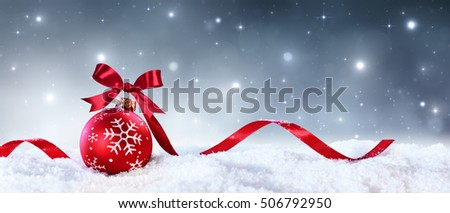 Red Sphere With Bow And Ribbon On Snow - Christmas Card