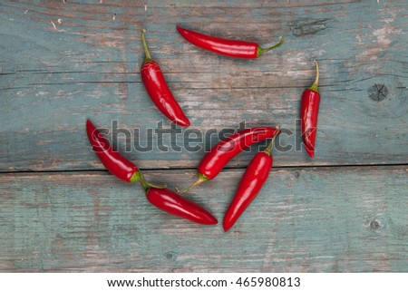 Red, spicy peppers on a wooden table, stock pictures
