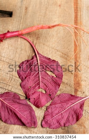 red spinach on a wooden vintage