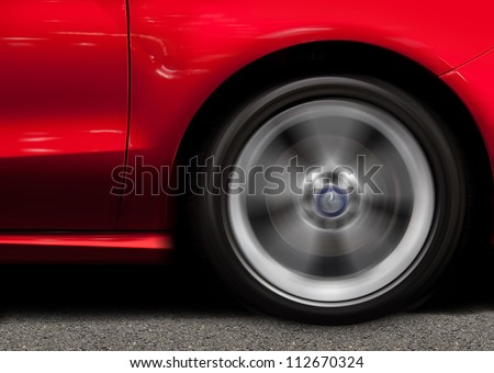 Red Sports Car in Motion - stock photo