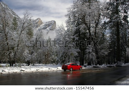Red Sportscar in a snowy Yosemite Valley - stock photo