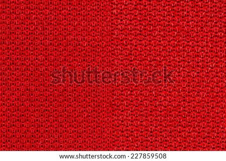 Red sportswear fabric texture closeup photo background. - stock photo