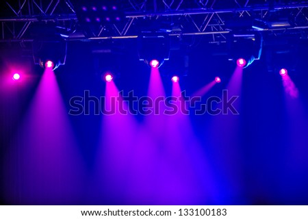 Red spotlights on empty stage