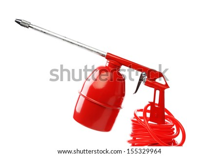 Red spray gun. - stock photo