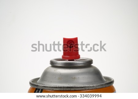 Red spray head of orange spray can on white background. - stock photo