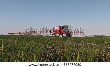 red sprayer in green wheat field - stock photo