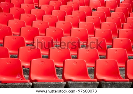 Red stadium seats on the stand
